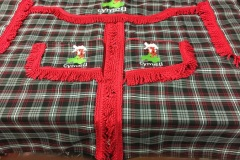Cab curtain set in Auld Lang Syne tartan with red bullion.  Embroidered with map of Wales design