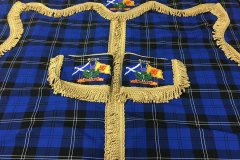 Cab curtain set comprising two front curtains, a pair of tiebacks and a pelmet in Ramsay (New Blue) tartan with gold bullion trim, featuring the Saltire and Lions Rampant flags and personalised to customer specification.