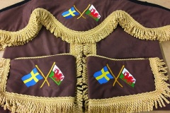 Brown faux suede pelmet and tiebacks with gold bullion.  Swedish & Welsh flags embroidery