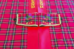 Cab curtains set in Stewart Royal tartan with complementing red faux leather front panel.